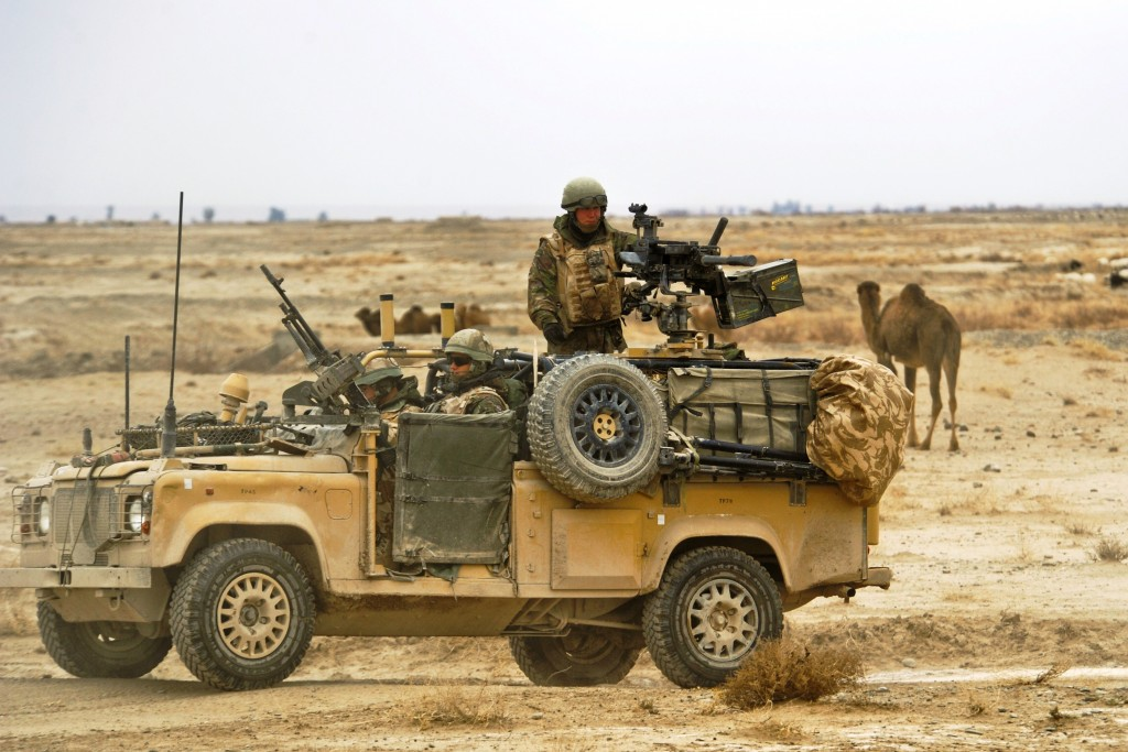 U.K. service members with B Flight, 27 Squadron, Royal Air Force Regiment stop on a road while conducting a combat mission near Kandahar Airfield, Afghanistan, Jan. 2, 2010. (U.S. Air Force photo by Tech. Sgt. Efren Lopez/Released)