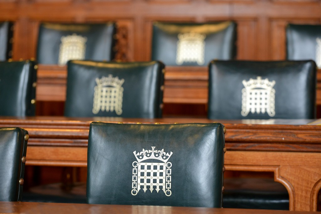 FNN0W1 Chairs showing portcullis crest in a Palace of Westminster committee room