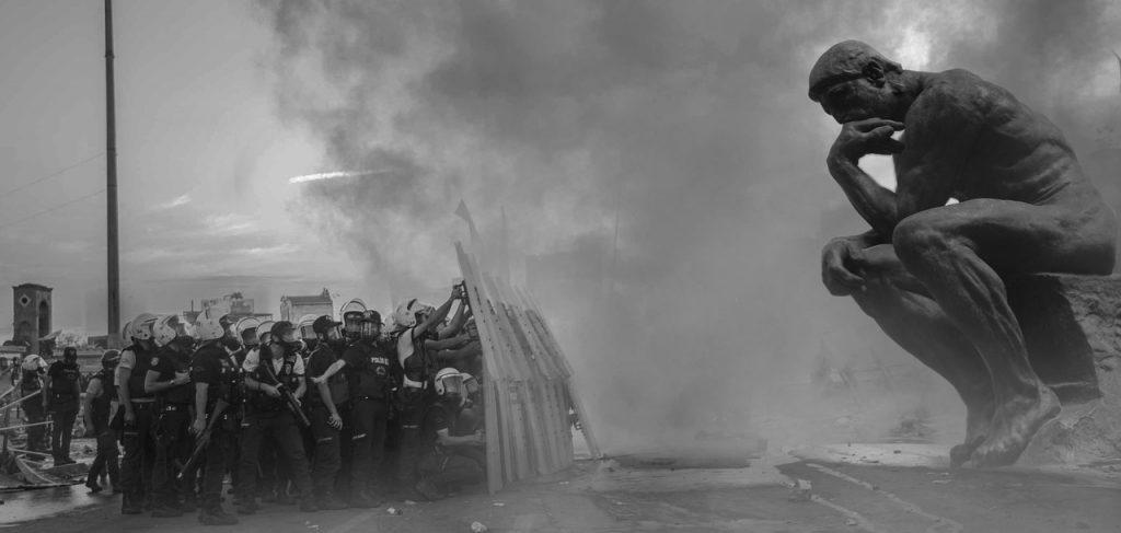 Thinker vs riot police